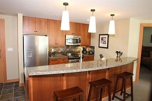 Kitchen property cabinetry cottage hardwood home cuisine classique countertop stainless appliance steel Island