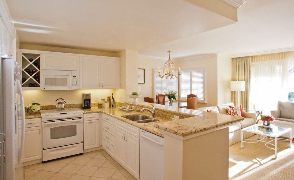 Kitchen property home hardwood cuisine classique cottage white appliance cabinetry farmhouse living room Island