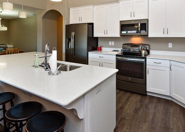 Kitchen property countertop cabinetry home hardwood cuisine classique cuisine flooring appliance Island