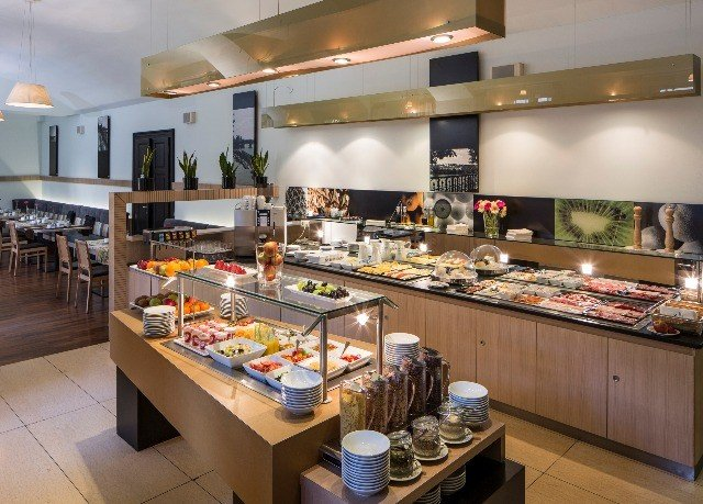 Kitchen property counter bakery food delicatessen restaurant buffet cafeteria cuisine fast food restaurant Island