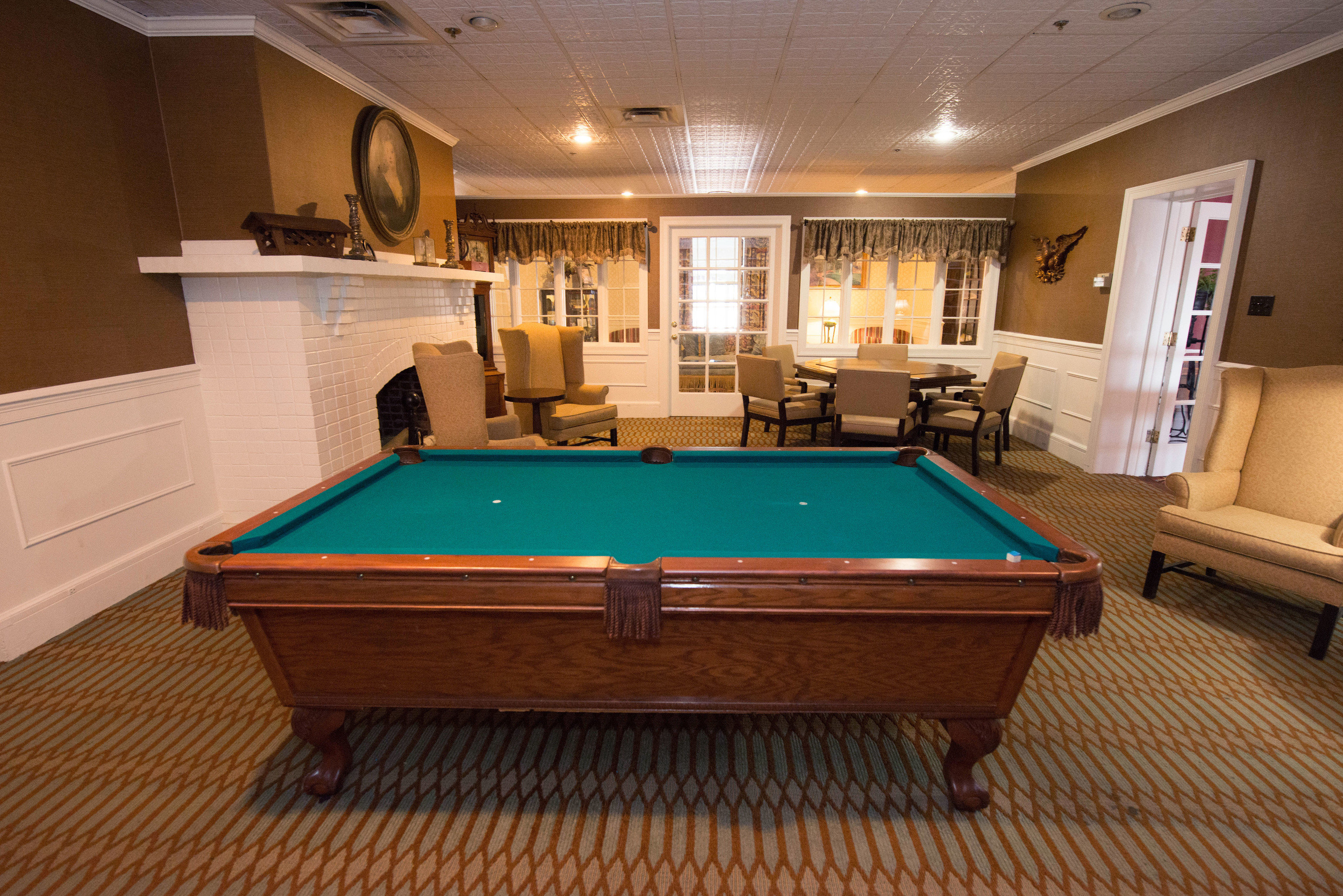 pool table poolroom billiard room recreation room Kitchen pool ball property swimming pool billiard table counter basement games Island