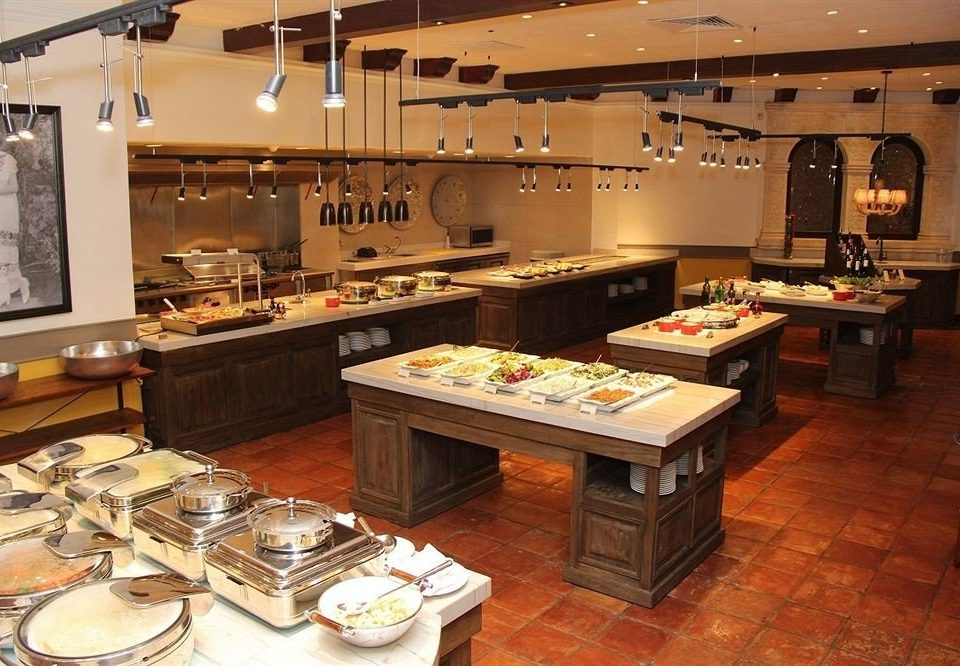 property Kitchen cuisine food home buffet cabinetry recreation room restaurant countertop Island cluttered