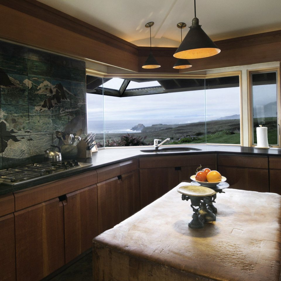 cabinet Kitchen property counter home house countertop cottage mansion vehicle cabinetry Island