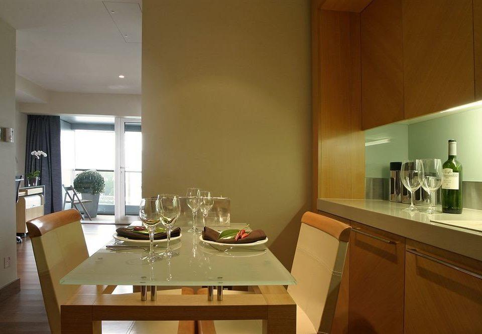 property Kitchen home condominium hardwood counter lighting cabinetry cottage countertop Island