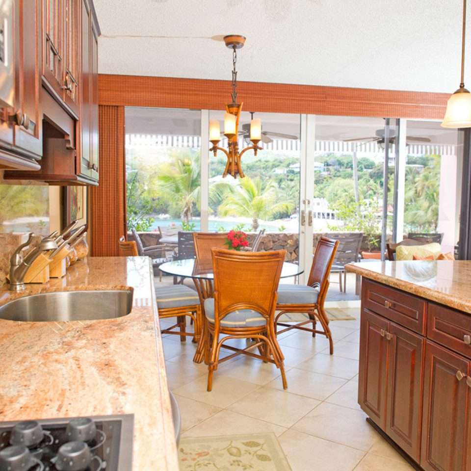 Kitchen property home countertop hardwood cottage cuisine classique farmhouse cabinetry wood flooring Island
