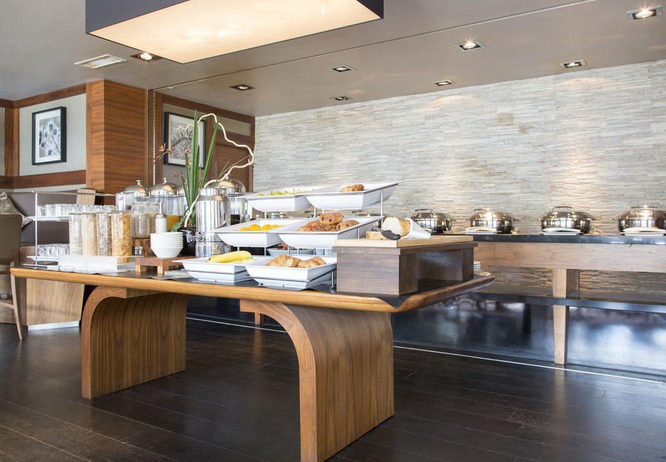 property Kitchen countertop hardwood cabinetry food home counter flooring cuisine wood flooring restaurant hard Island