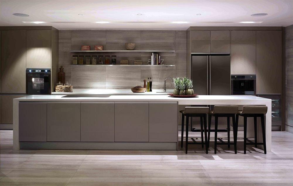 Kitchen property countertop cabinetry hardwood cuisine classique home lighting flooring wood flooring cuisine living room Island