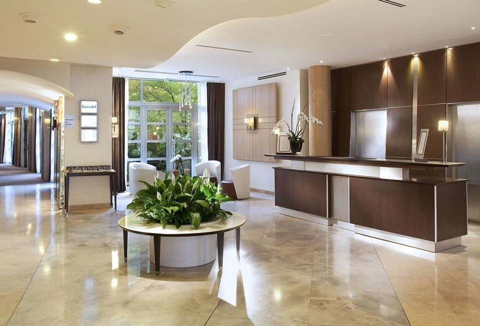 property building Lobby home green lighting flooring condominium wood flooring living room Kitchen cabinetry Island