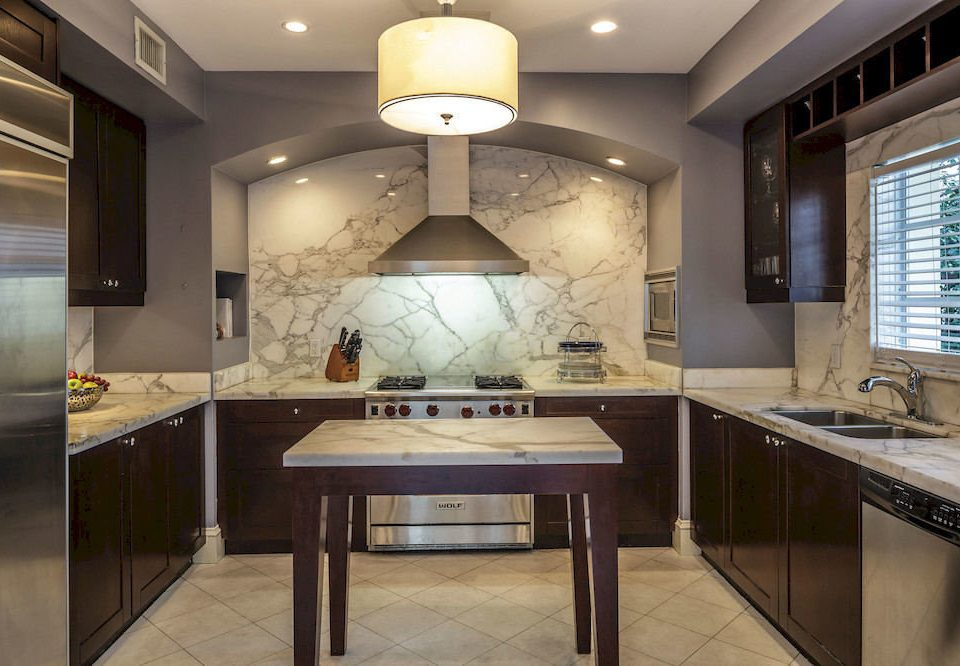 Kitchen property countertop cabinetry home hardwood counter lighting cottage mansion Island Modern appliance