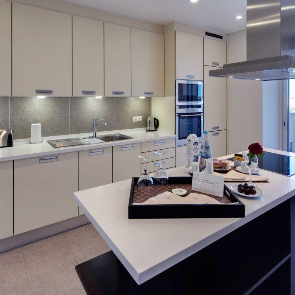 Kitchen property counter home condominium countertop appliance Modern Island