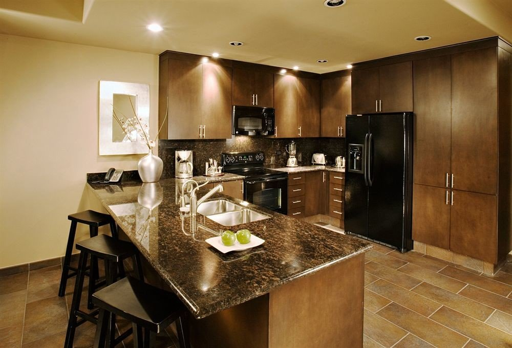 Kitchen property stainless steel cabinetry countertop home cuisine classique counter cottage Modern silver appliance Island