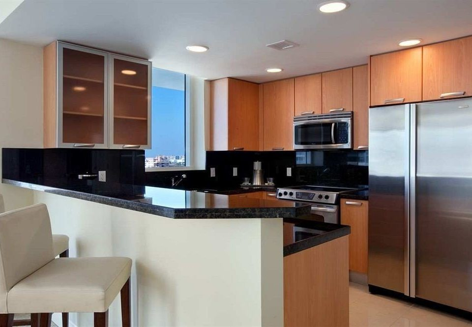 Kitchen cabinet property cabinetry home condominium hardwood stainless cuisine classique steel countertop living room Modern appliance Island silver kitchen appliance