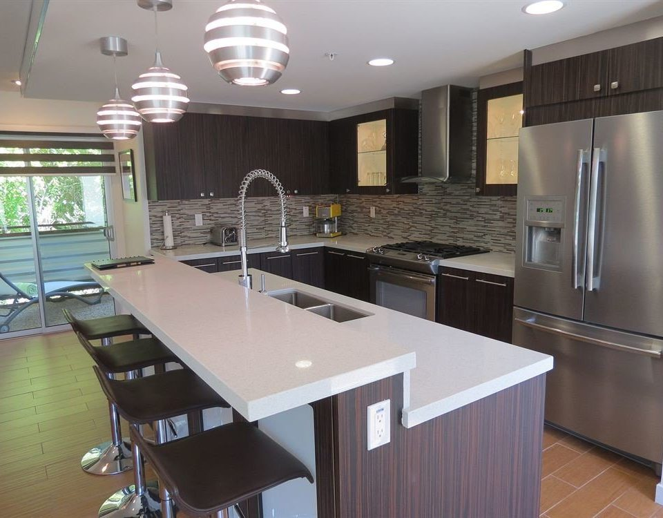 property Kitchen countertop cabinetry home Island counter cuisine stainless Modern steel