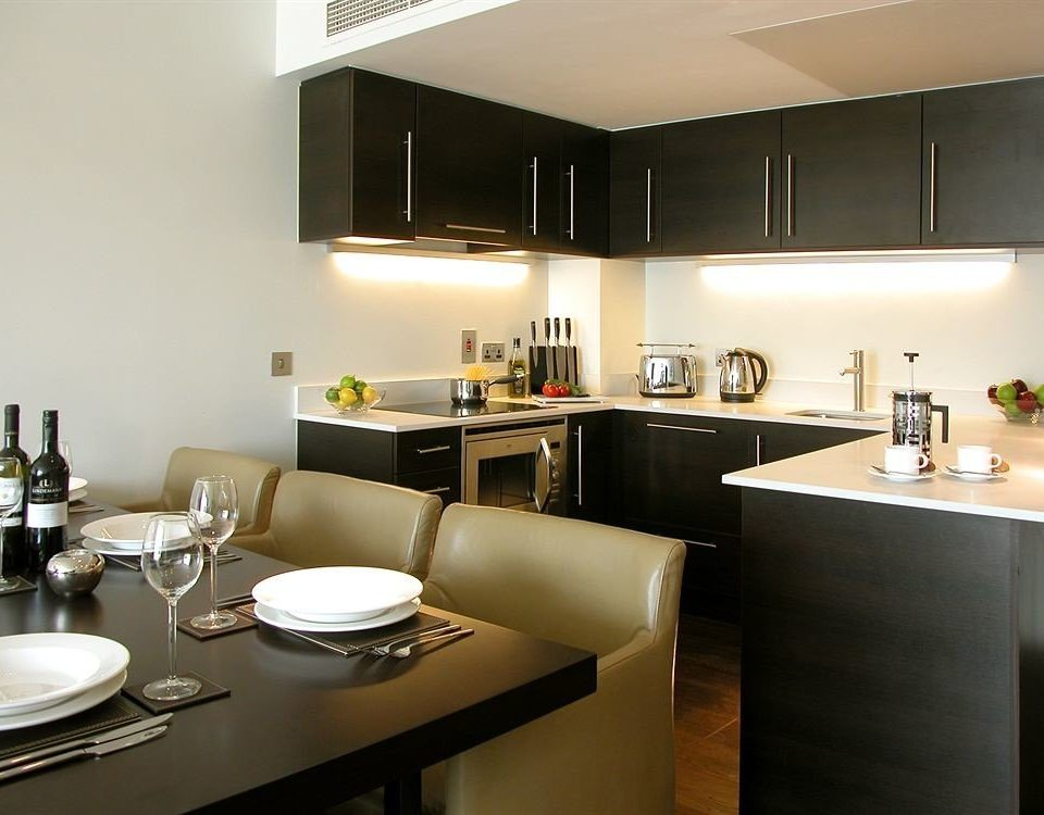 property condominium Kitchen cuisine lighting home restaurant living room Suite Modern appliance Island dining table