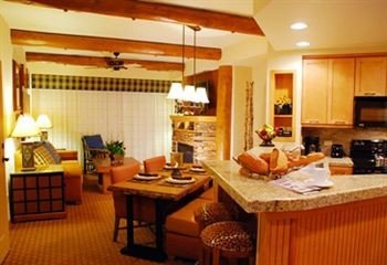 Kitchen property Suite cottage home living room condominium Villa Resort counter Island appliance
