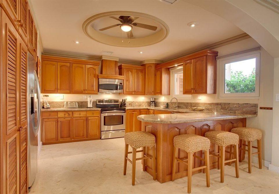 Kitchen property home cabinetry hardwood cuisine classique cottage mansion farmhouse Suite appliance Island