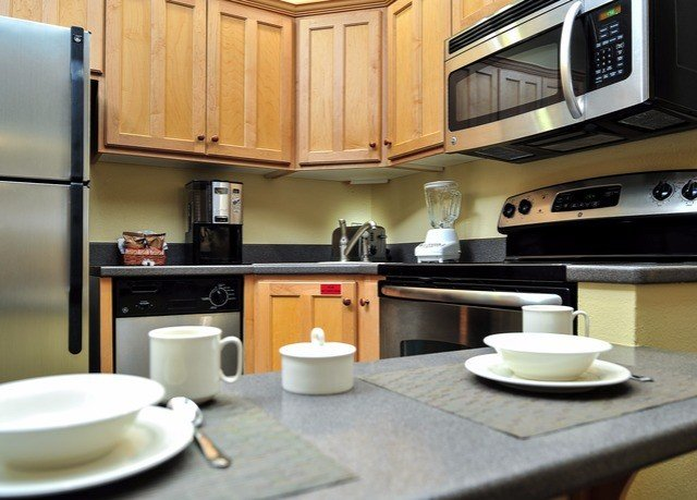 cabinet Kitchen property countertop home cabinetry cuisine Suite cottage food counter condominium appliance kitchen appliance Island