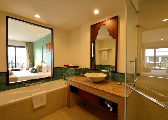 bathroom sink property mirror home condominium Kitchen hardwood counter Suite cabinetry cottage countertop Island