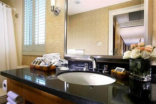 property countertop sink home counter Kitchen Suite condominium cottage Island cluttered