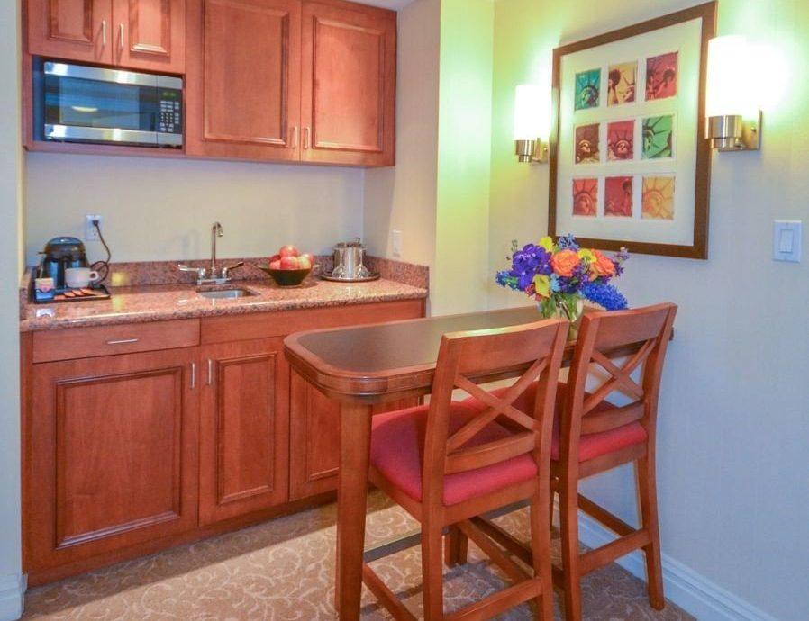 Kitchen cabinet property home cottage hardwood Suite recreation room Villa appliance Island