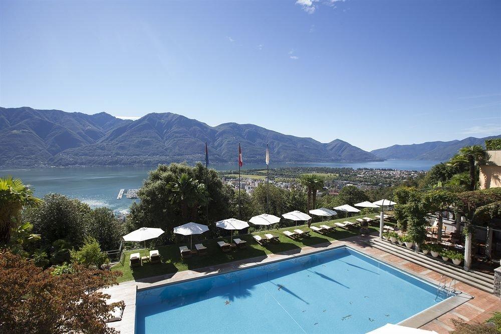 sky mountain water swimming pool Resort mountain range Lake Villa overlooking Island