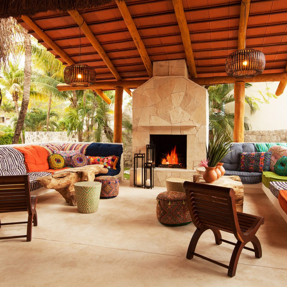 Island Lounge property living room home porch cottage Villa farmhouse outdoor structure log cabin backyard Patio Resort hacienda stone