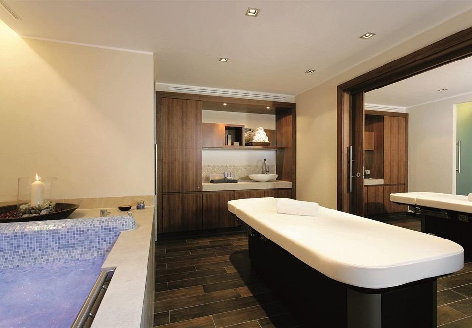 property swimming pool Suite sink counter condominium bathroom Modern Island