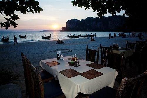 water tree sky Nature restaurant Ocean Resort overlooking shore Island