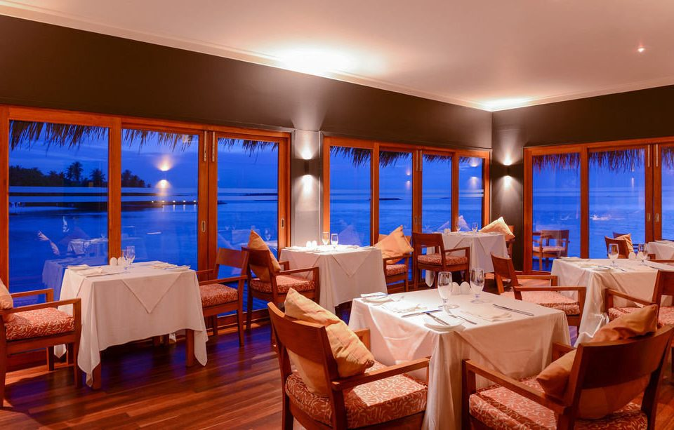 chair property Resort restaurant Suite function hall living room Island