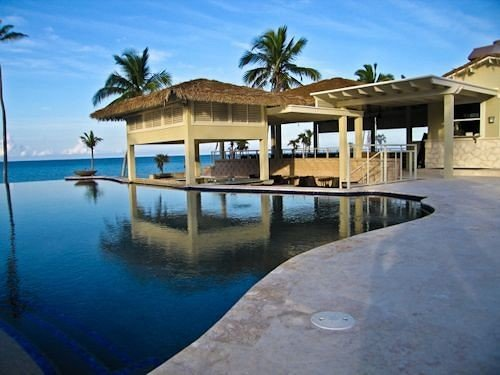 sky water property building Resort house Villa swimming pool home condominium lined Island shore