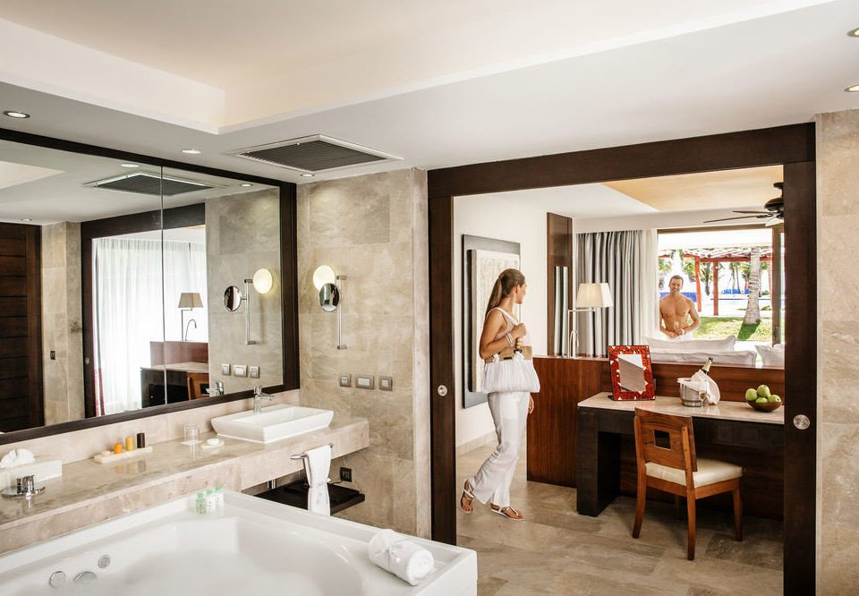 property home Suite sink bathroom condominium living room cabinetry Island