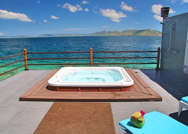 water sky swimming pool property leisure wooden jacuzzi Villa overlooking yacht caribbean shore Island