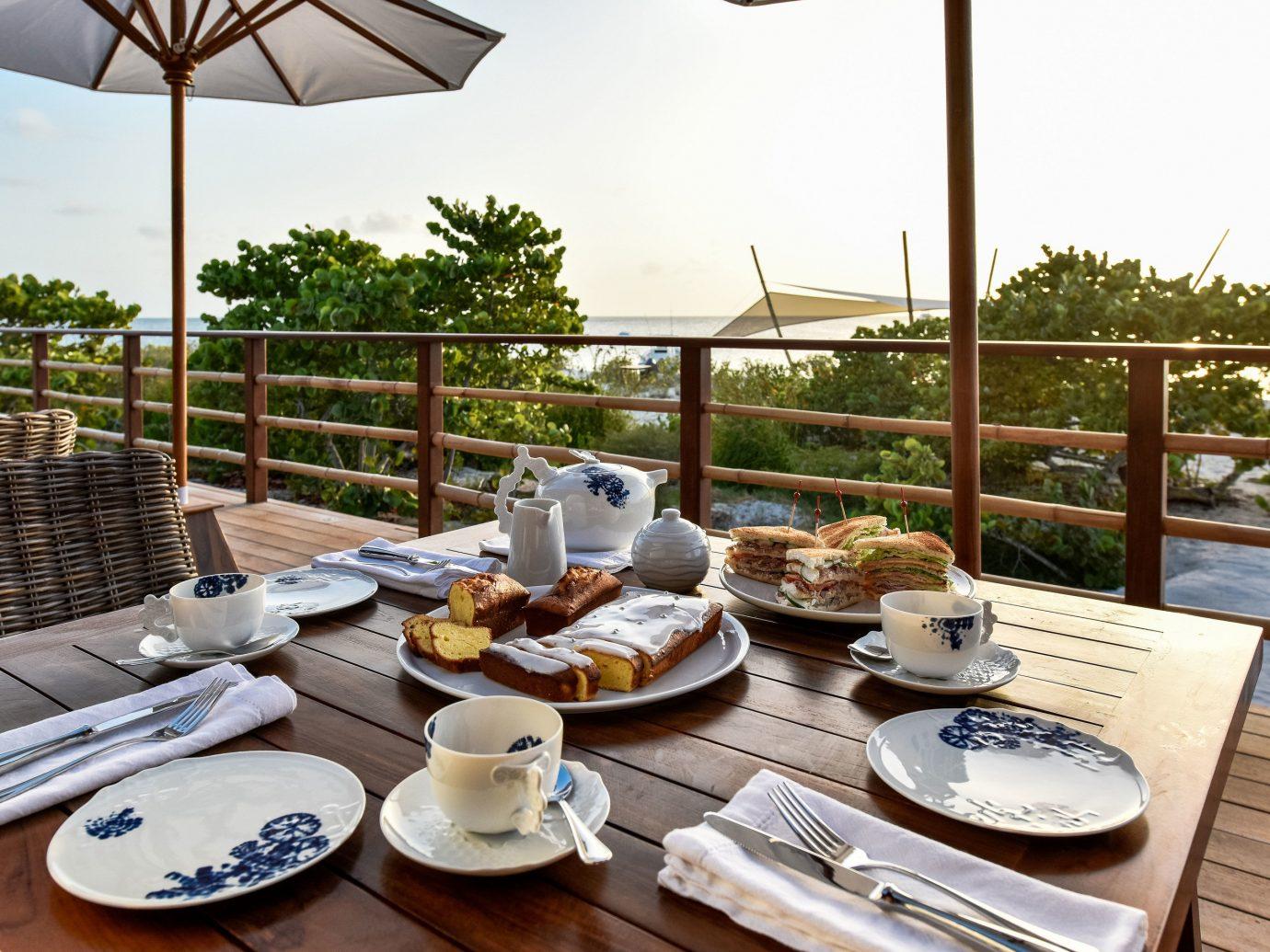 Trip Ideas table sky outdoor food plate meal room restaurant home estate Resort cottage brunch set