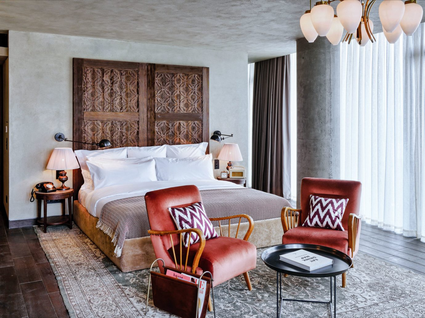 Boutique Hotels Hotels Luxury Travel floor indoor room chair interior design wall Living Suite living room furniture home ceiling Bedroom window interior designer bed frame table decorated