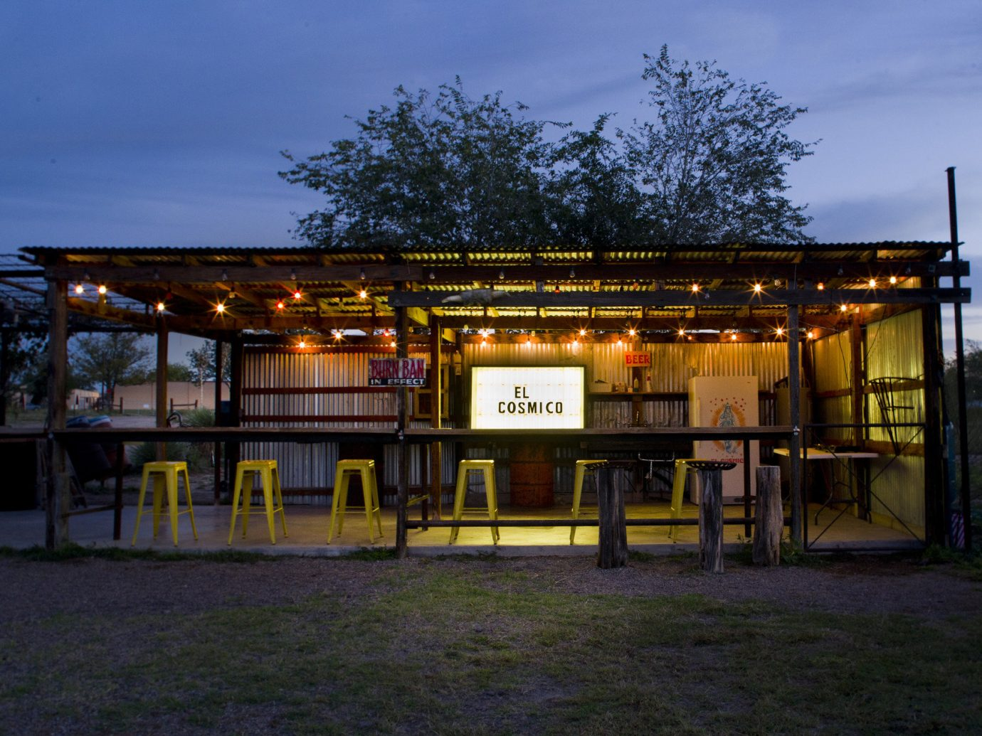 artistic artsy Bar bar seating dusk Glamping Hip isolation lights Nature night lights Night Sky Nightlife outdoor bar Outdoors Outdoors + Adventure quirky remote Rustic trees trendy Weekend Getaways outdoor sky grass night evening home sign