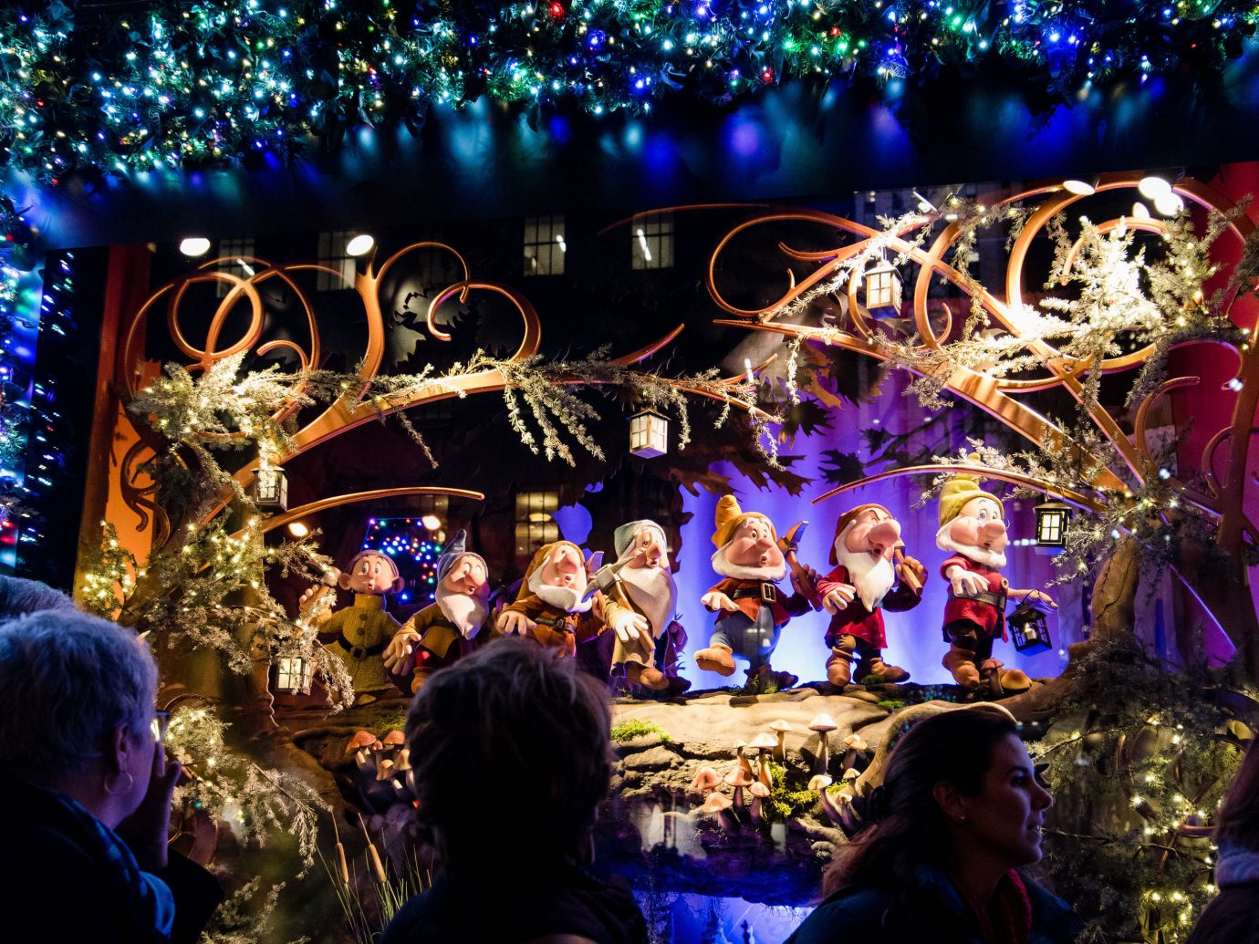 Offbeat Winter person christmas decoration christmas lights Entertainment event lighting Christmas festival nativity scene stage decor fête tradition night musical theatre holiday theatrical scenery recreation decorated crowd
