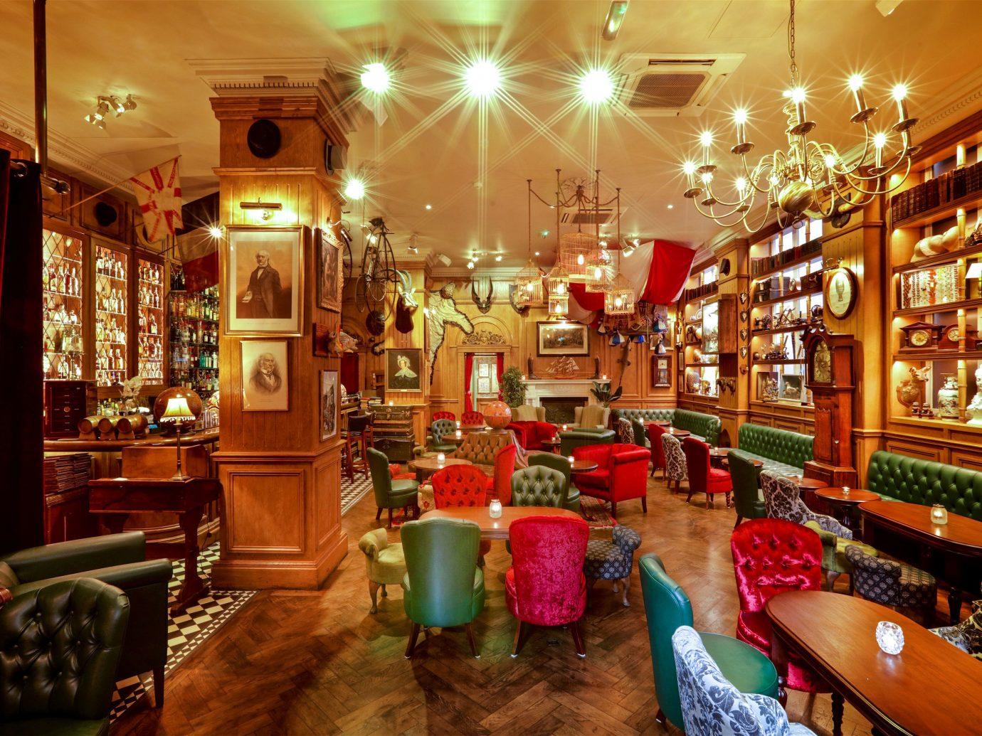 Food + Drink Trip Ideas indoor interior design Bar restaurant cluttered several