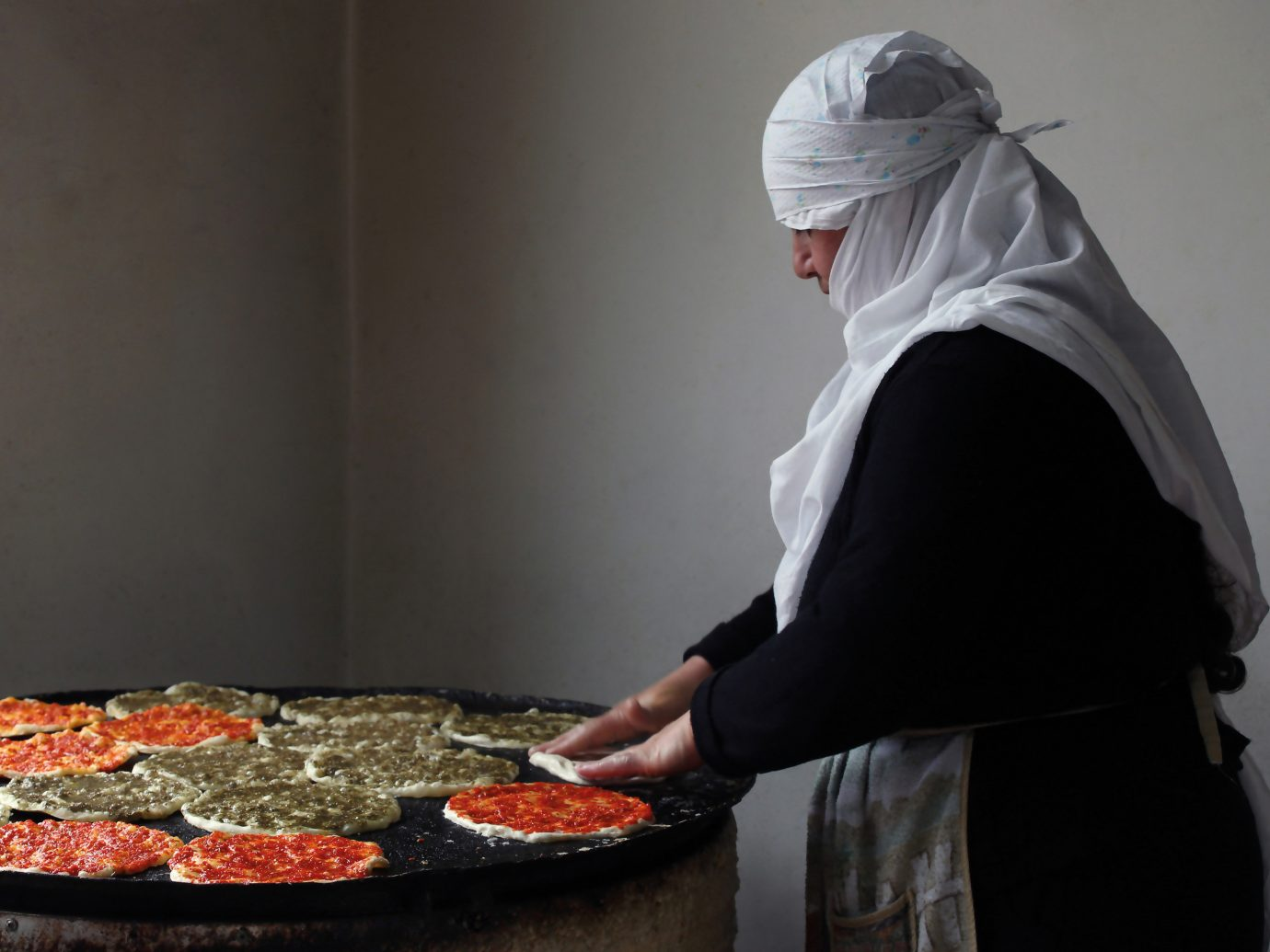 Food + Drink person wall indoor dish cuisine food sense cooking preparing