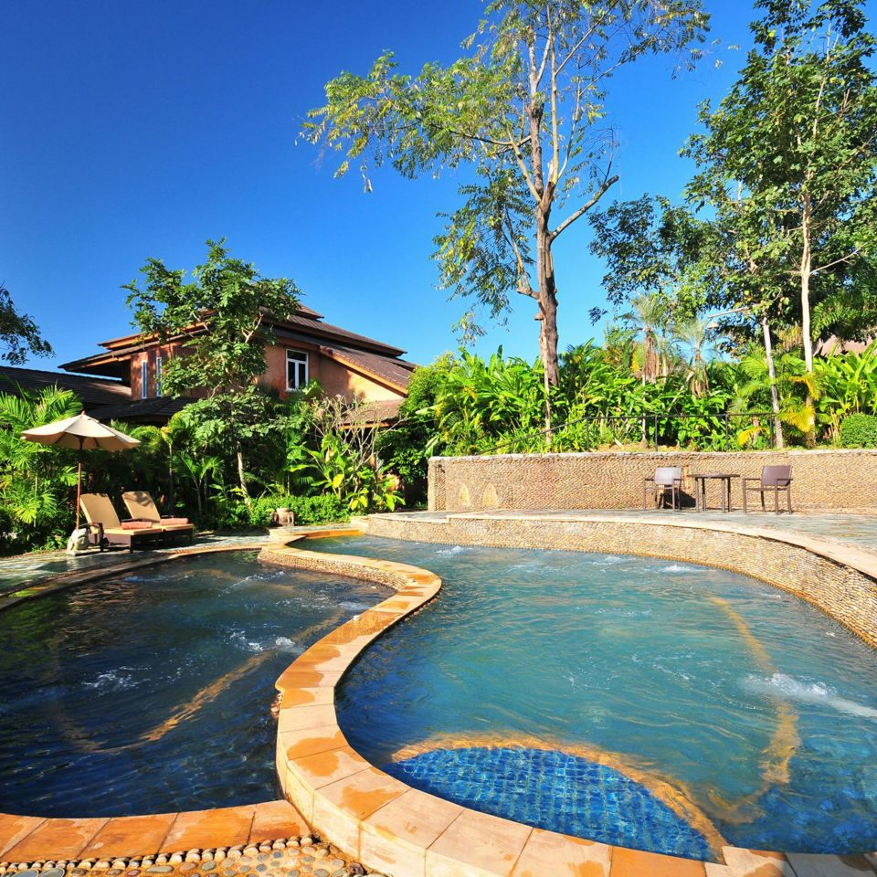 Jungle Patio Pool Tropical tree sky swimming pool leisure property Resort backyard Villa mansion swimming