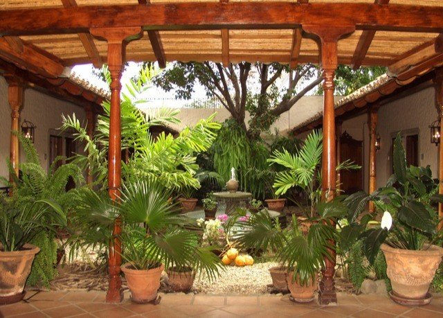 property Resort plant building hacienda Villa porch eco hotel Jungle cottage backyard outdoor structure dining table