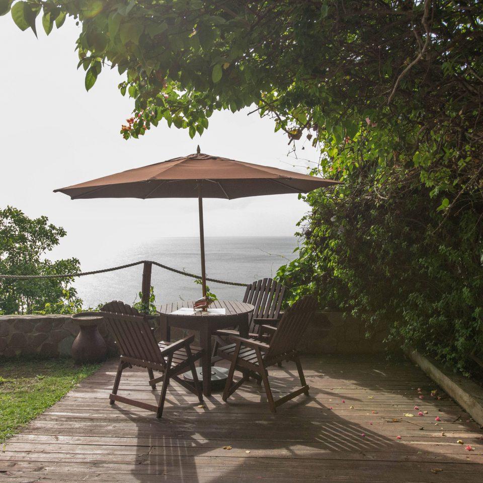 tree ground building house Resort porch cottage Villa Village Jungle shade