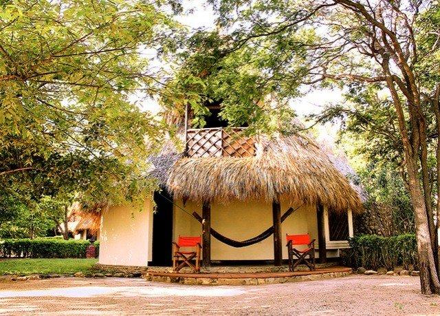 tree ground hut house home rural area cottage Village Resort thatching hacienda Jungle