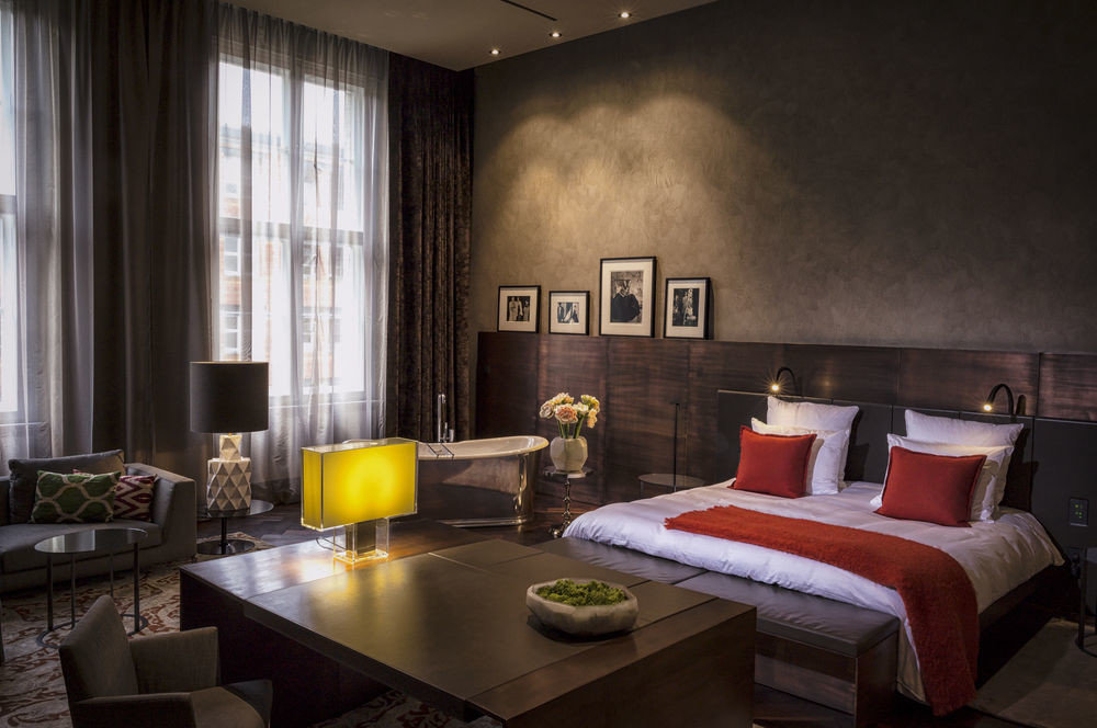 Berlin Boutique Hotels Germany Hotels Luxury Travel indoor wall table window floor room living room property ceiling hotel interior design home estate Suite Design real estate condominium window covering apartment furniture area