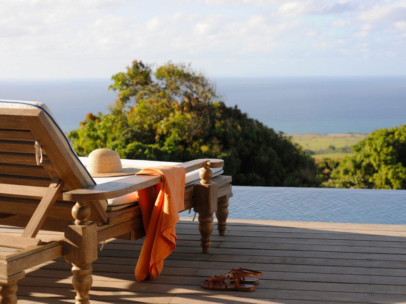 Hotels sky outdoor water leisure vacation furniture wooden wood Beach walkway overlooking seat Deck