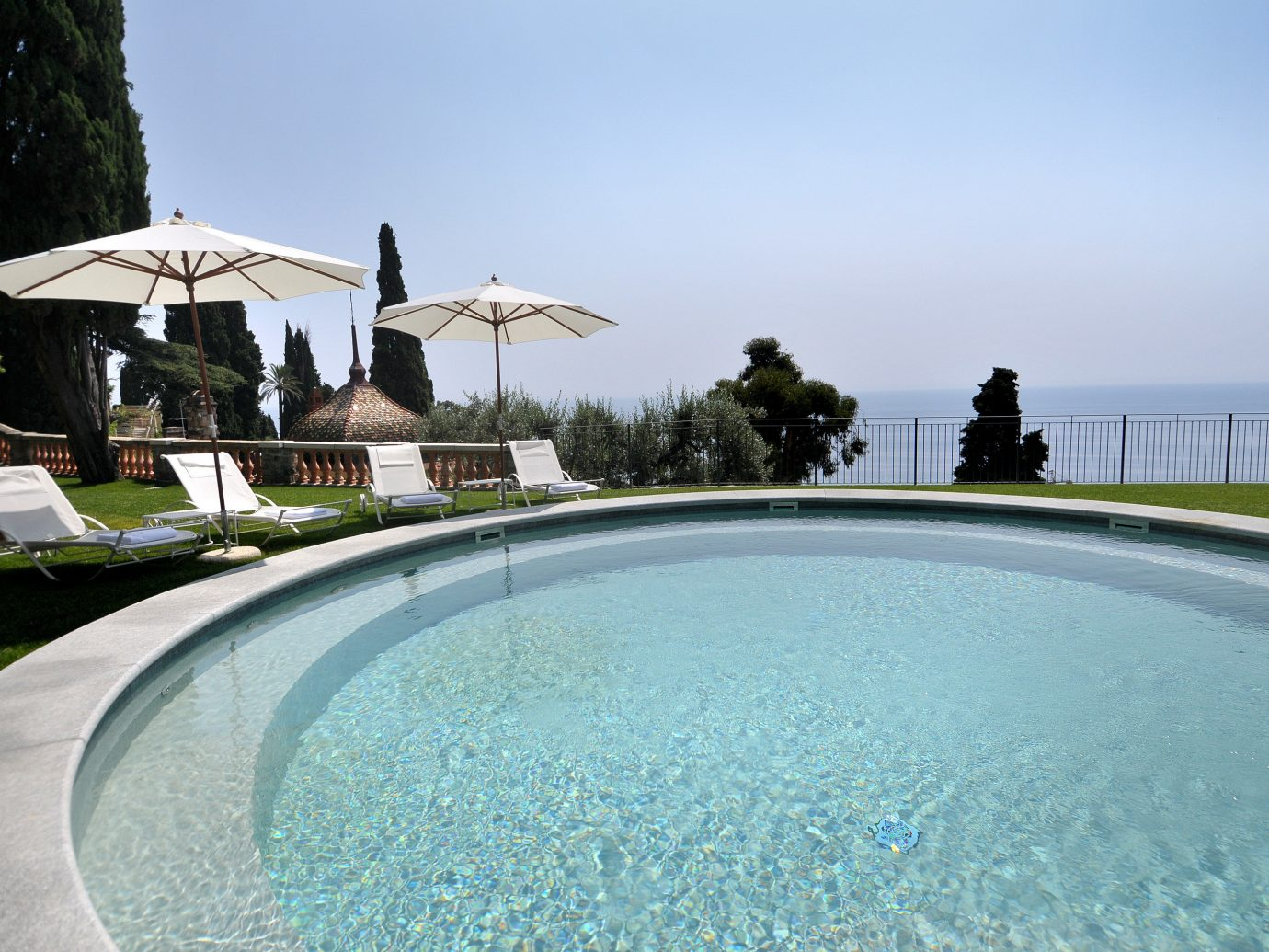 Italy Trip Ideas swimming pool water property Resort estate leisure Villa real estate vacation sky Sea house tourism resort town tree