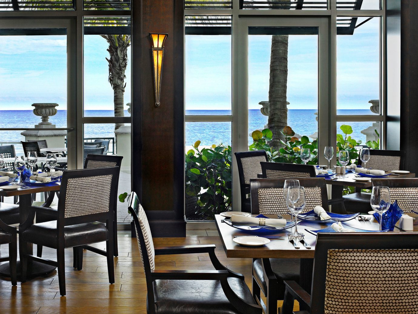 Beachfront Dining Eat Family Modern Trip Ideas chair floor window indoor room property estate restaurant condominium home dining room interior design Resort real estate apartment living room area furniture dining table