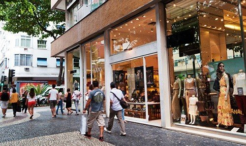 Jetsetter Guides building outdoor road walking plaza retail shopping mall people shopping pedestrian City outlet store