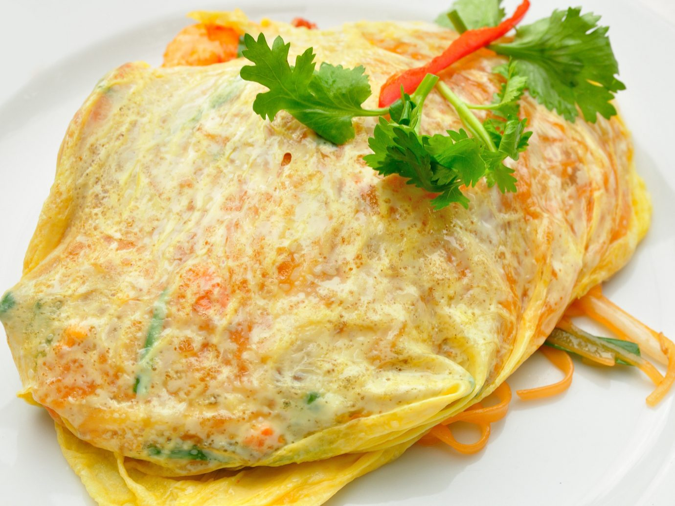 Jetsetter Guides food plate dish omelette meal breakfast cuisine omurice white fish produce tortilla de patatas frittata vegetable sauce omelet meat