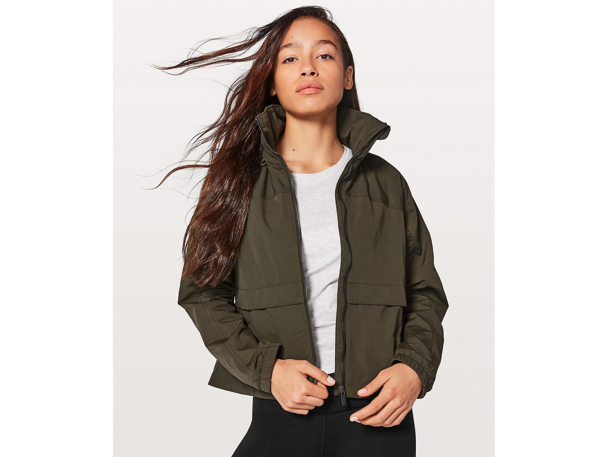 Health + Wellness Style + Design Travel Shop clothing person coat jacket posing hood fur overcoat fashion model neck