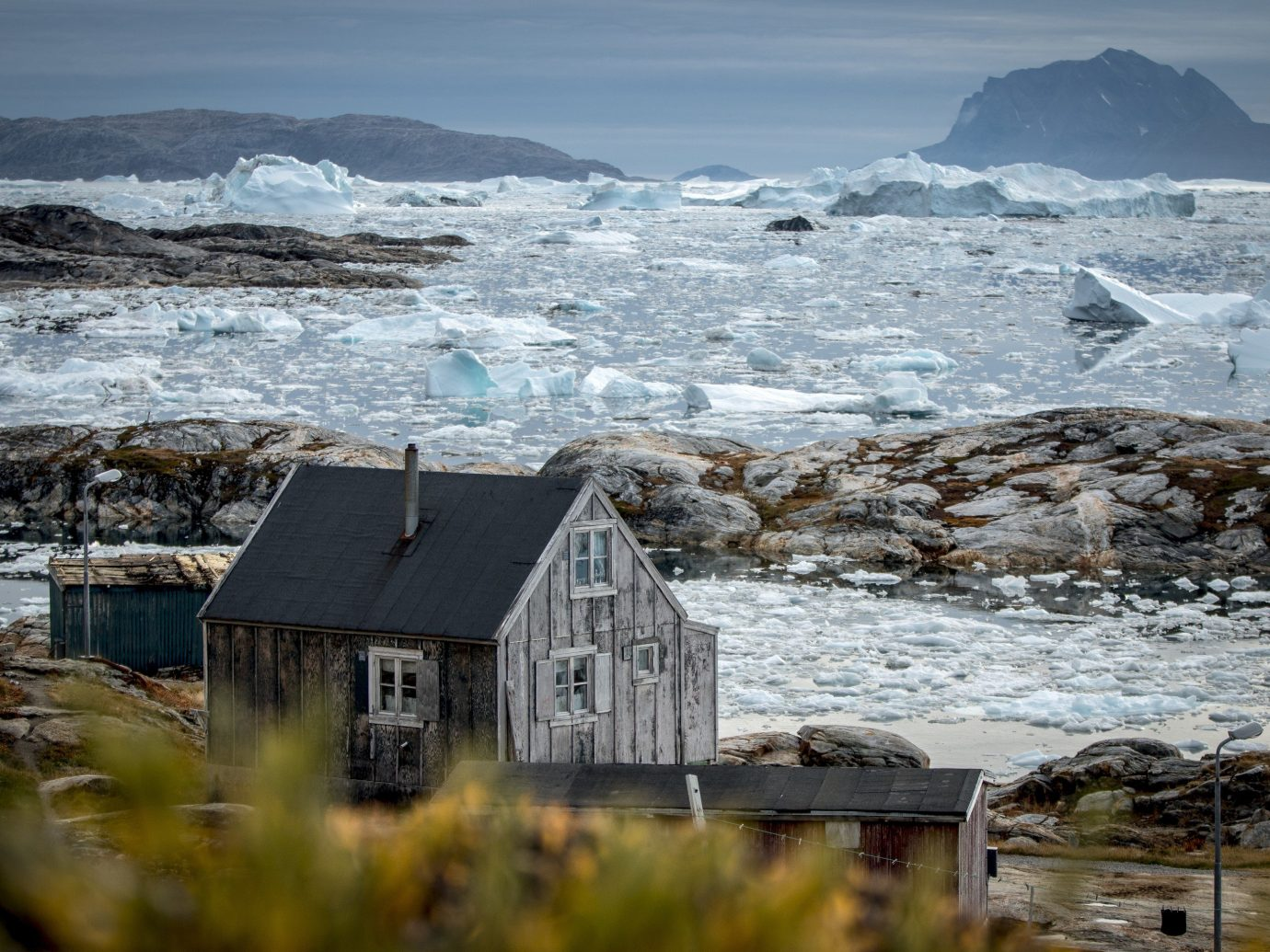 A house in Tiniteqilaaq with a view of the Sermilik Icefjord in East Greenland
